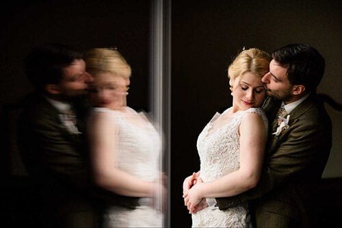 Bride and groom together at Pendrell Hall with reflection on wall