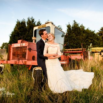 Bride and groom relaxing with old tractor at Wishaw Country Sports