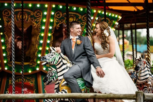 Bride and groom riding carousel at Spring Grove House wedding