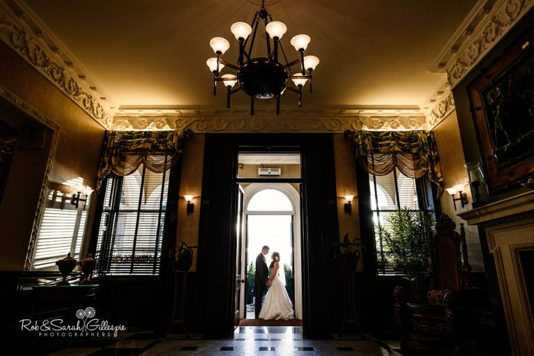 Bride and groom in doorway at Spring Grove House