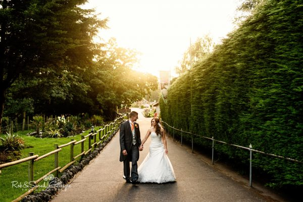 Bride and groom walking thorugh safari park at Spring Grove House