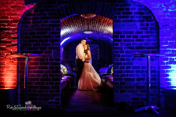 Bride and groom together in cellar room at Spring Grove House