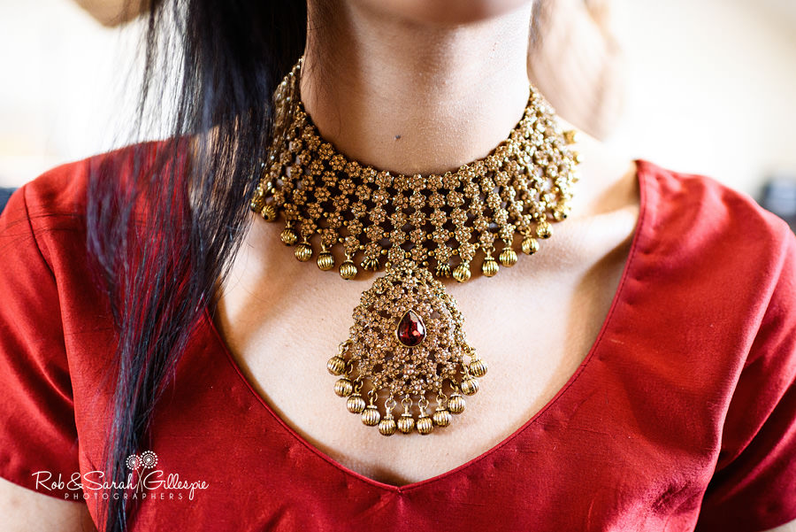 Close-up image of Indian wedding jewellery worn by bride