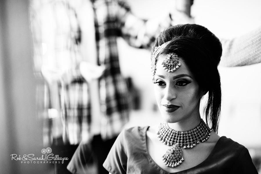 Bride in mirror preparing for wedding