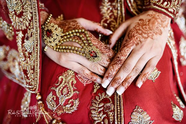 Detiail of bride's hand with henna at Warwick House