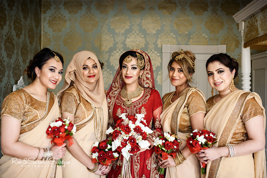 Group photo of bride and bridesmaids in Warwick House honeymoon suite