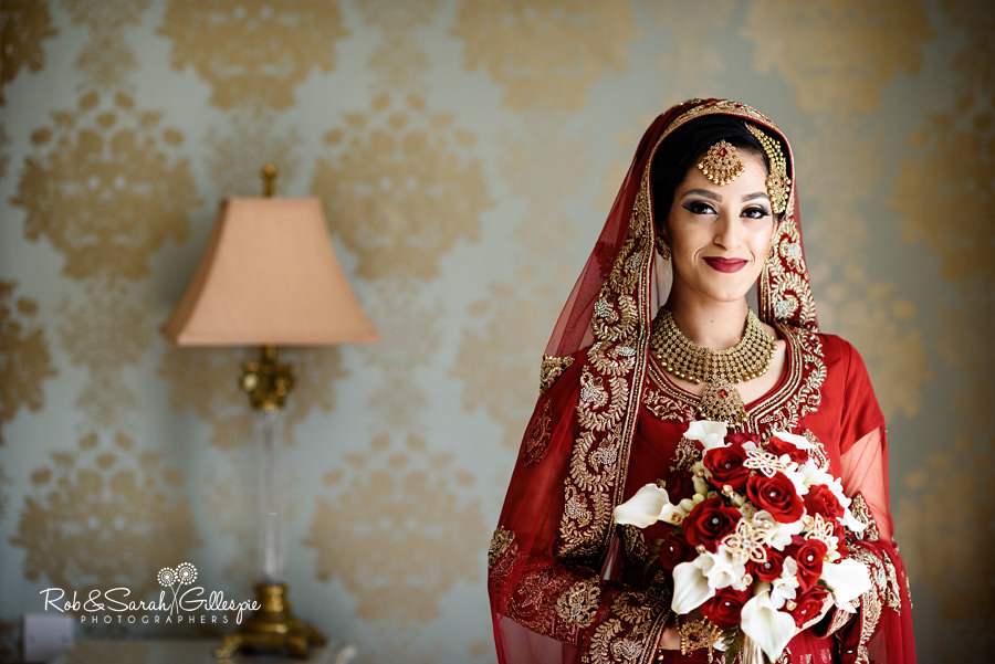 Portrait of bride in Indian wedding outfit