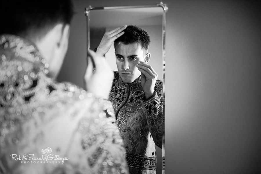Groom in mirror