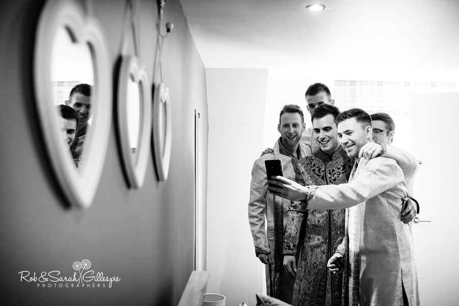 Groom and friends take selfi photo before wedding at Warwick House