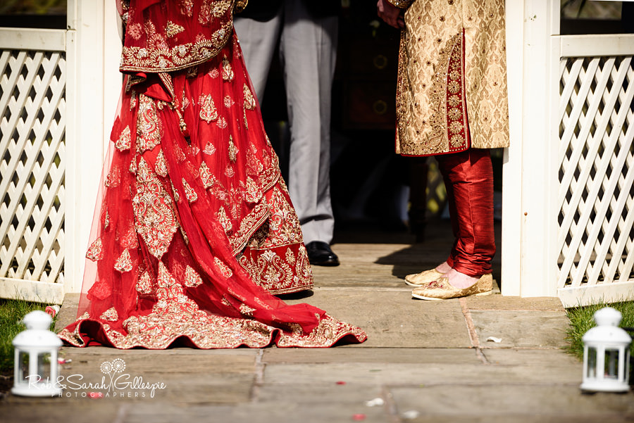 Bride and groom during wedding service at Warwick House outdoor ceremony
