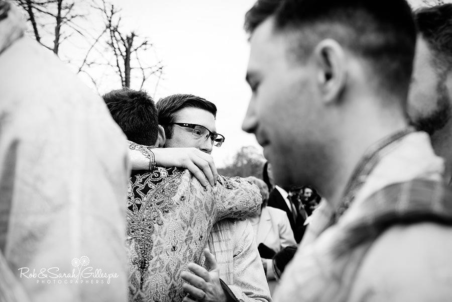 Wedding guests congratulate bride and groom