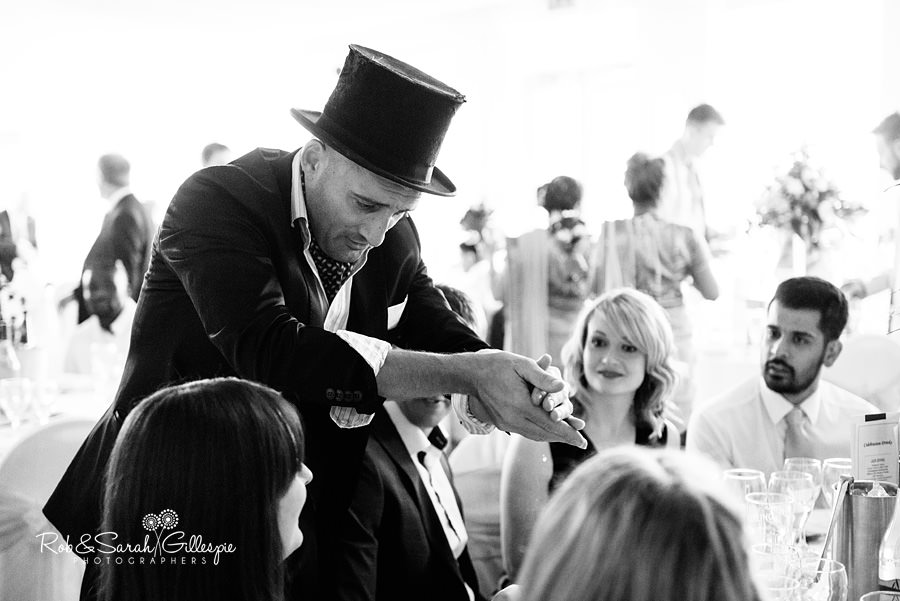 Magician perofrms at Warwick House wedding