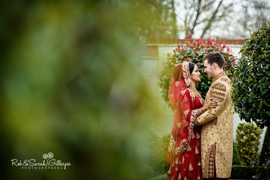 Bride and groom together in gardens at Warwick House