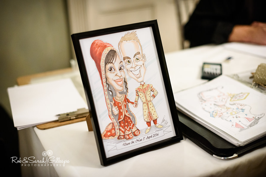 Caricature artist works during wedding reception at Warwick House