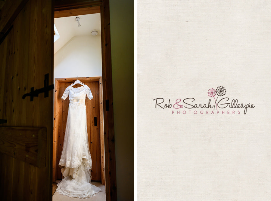 Lace wedding dress hanging in doorway