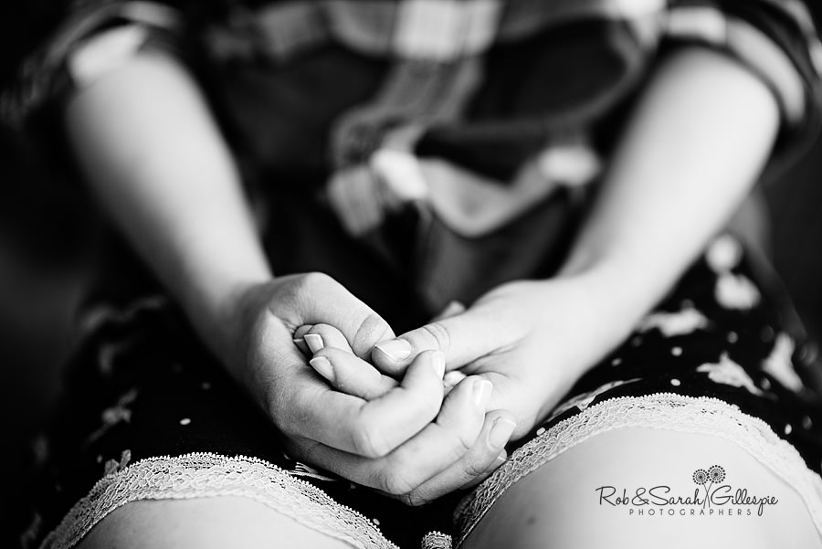 Bride's hands clasped as she gets ready for wedding