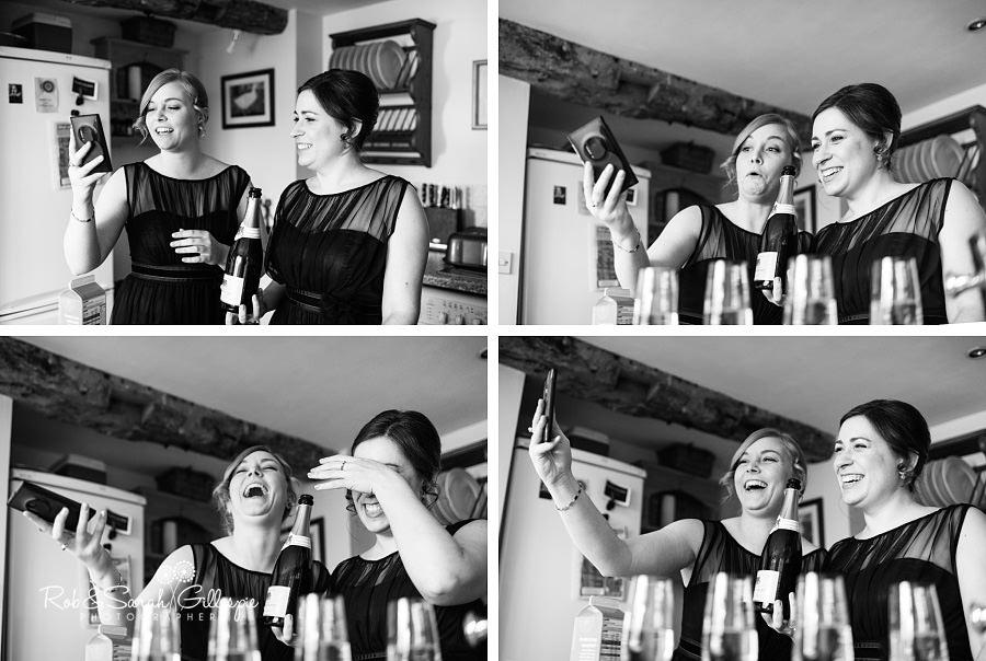 Bridesmaids laughing while taking selfi