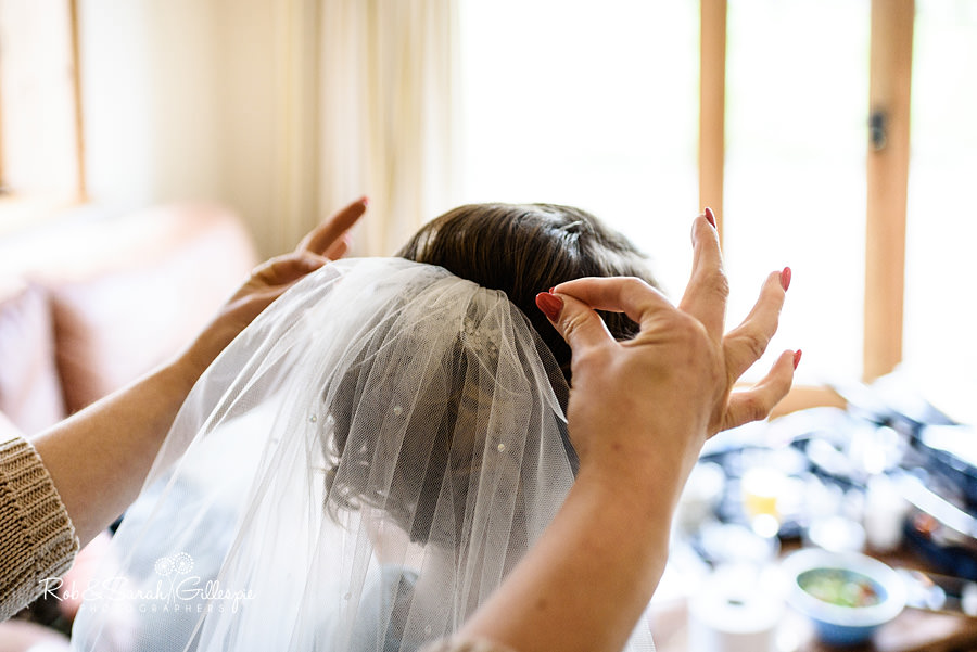 Bride has veil fixed in place before wedding