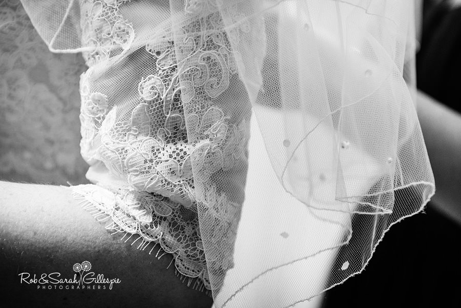 Detail of wedding dress sleeves and veil