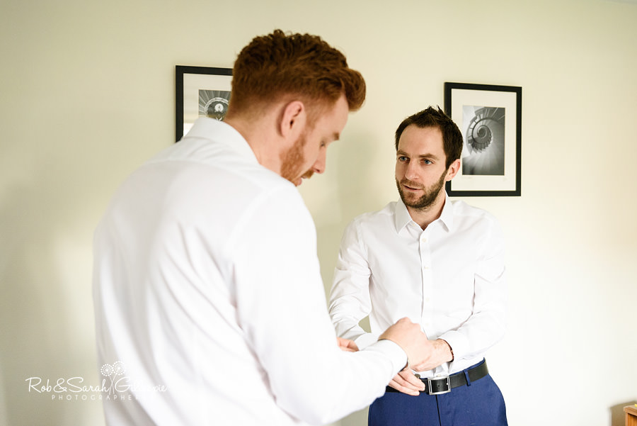 Groom and best-man getting ready for wedding