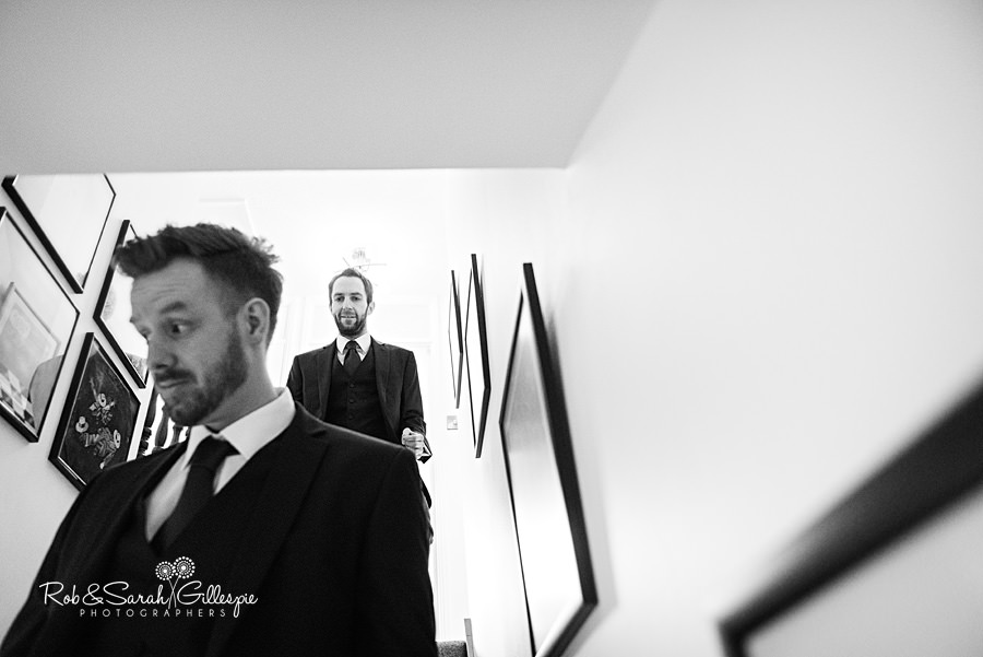 Best-Man and groom walk down stairway