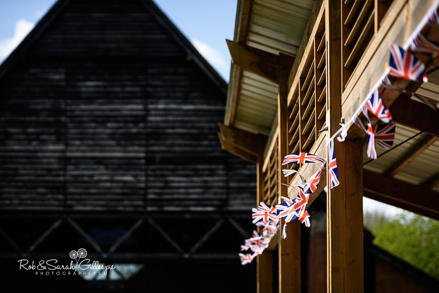 Union Flags flutter in breeze outside Avoncroft Guesten Hall
