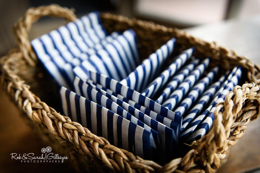 Close-up of confetti pouches in wicker basket