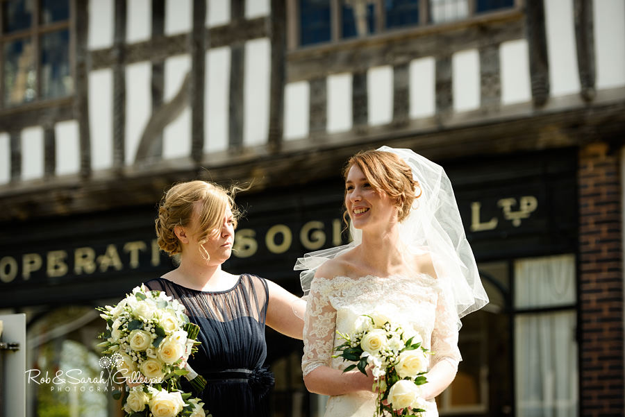 Bride and bridesmaid chat before wedding ceremony at Avoncroft Museum