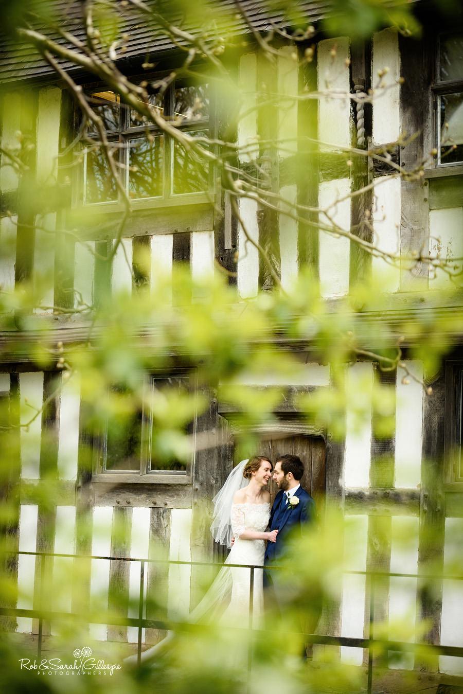 Bride and groom in doorway of old building at Avoncroft Museum