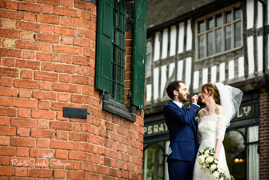 Bride and groom outside tea room at Avoncroft Museum wedding