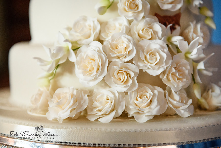 Detail of wedding cake with icing flowers