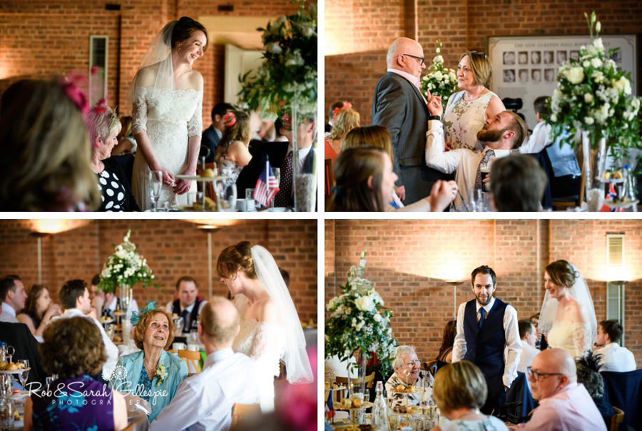 Bride and groom chat to wedding guests during meal