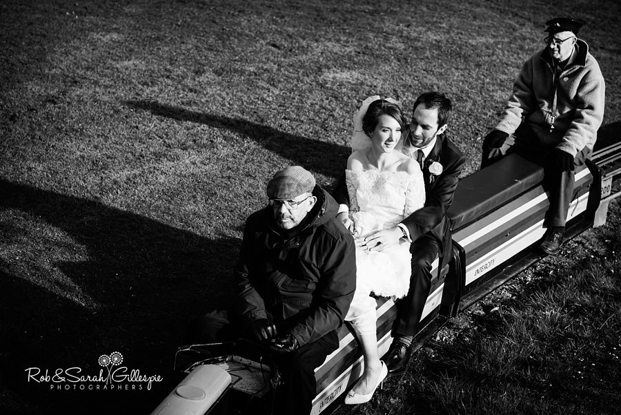 Bride and groom on miniature train at Avoncroft Museum wedding