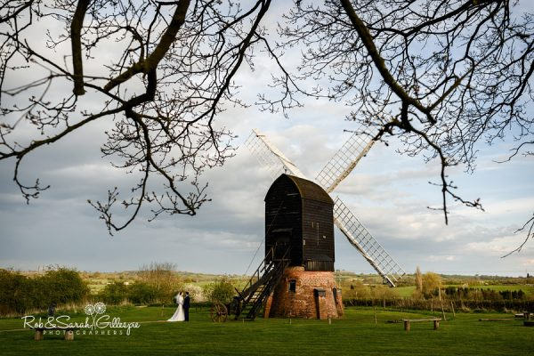 Bride and groom near windmill at Avoncroft Museum