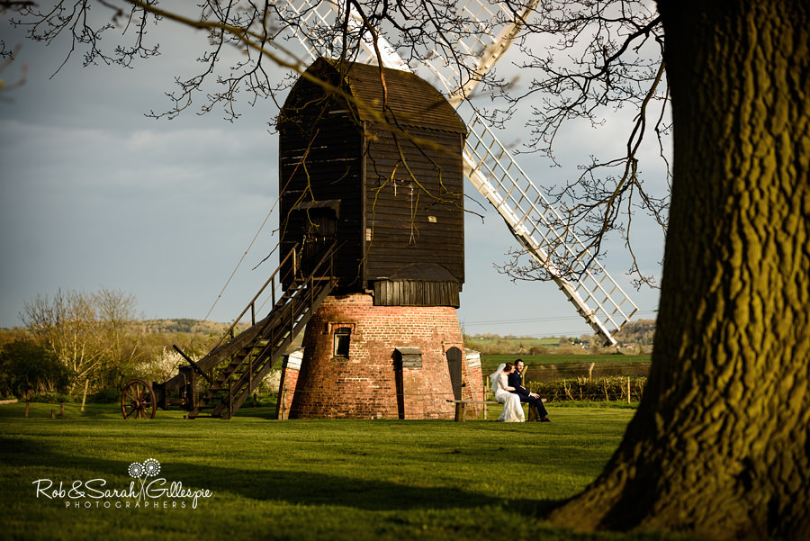 Bride and groom together with windmill at Avoncroft Museum wedding