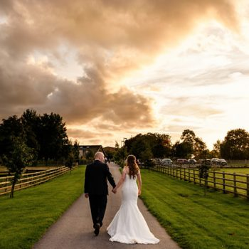 Bride and groom at Mythe Barn with beautiful sunset