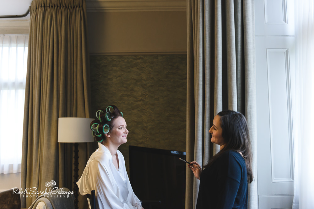 Bride having makeup applied at Hampton Manor wedding