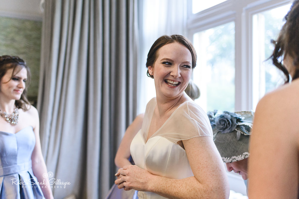 Bride and bridesmaids get ready for wedding at Hampton Manor