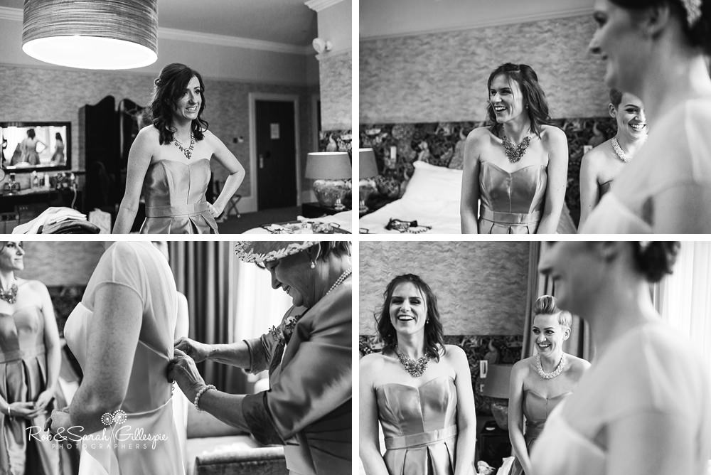 Bride and bridesmaids laughing while getting ready for wedding at Hampton Manor