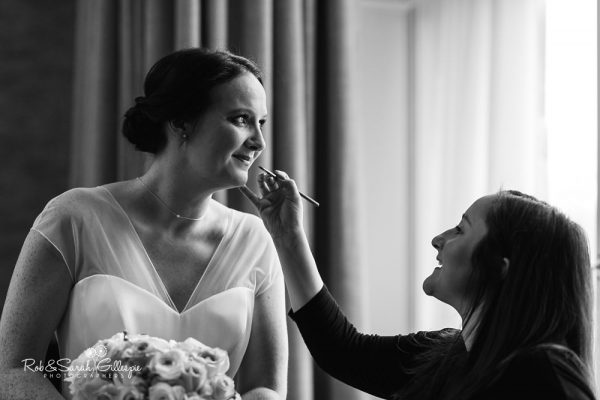 Bride prepares for wedding at Hampton Manor