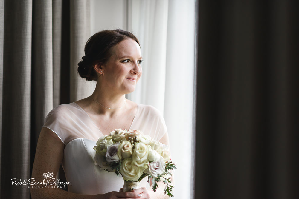 Portrait of bride in window at Hampton Manor