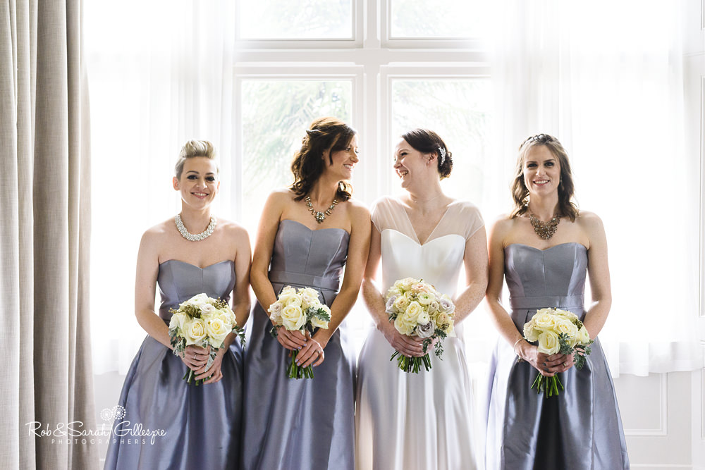 Group photo of bride and bridesmaids at Hampton Manor