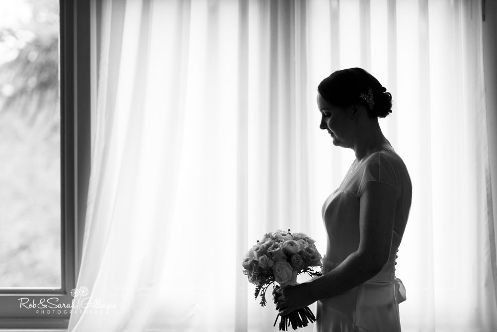 Silhouette of bride in window at Hamton Manor