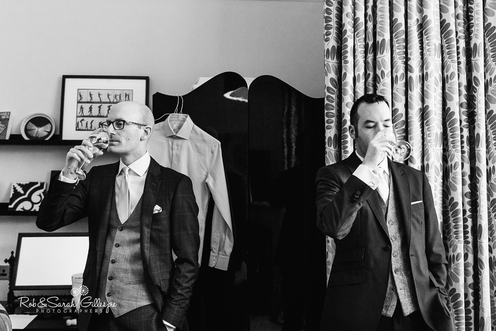 Groom and users get ready for wedding at Hampton Manor