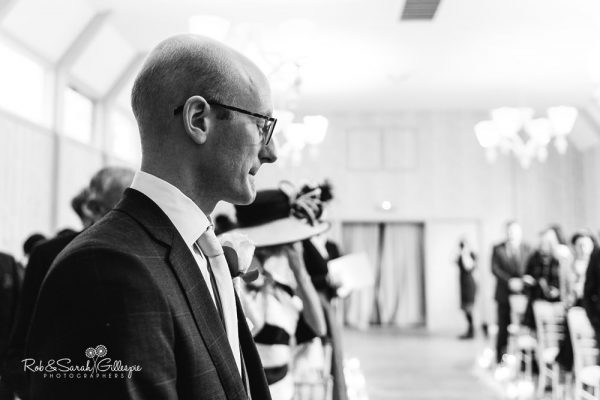 Groom nervously waits for bride at Hampton Manor wedding