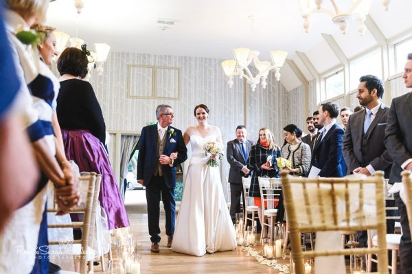 Brides walks up the aisle at Hampton Manor wedding