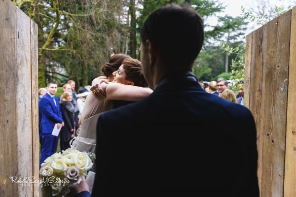 Wedding hugs at Hampton manor