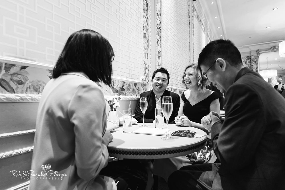 Documentary photo of wedding drinks reception at Hampton Manor