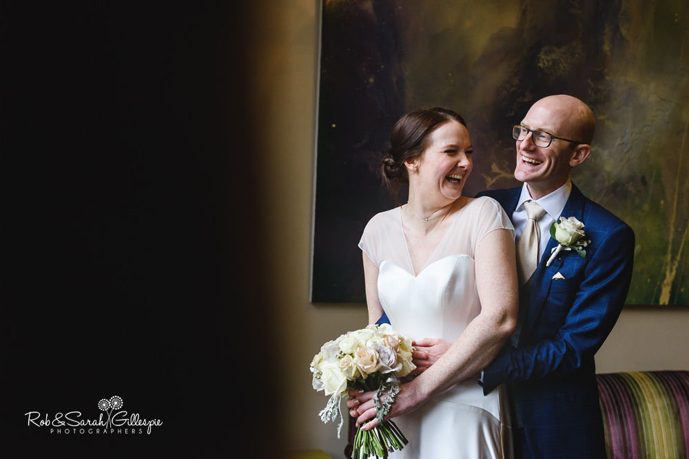 Bride and groom together in Hampton Manor grounds