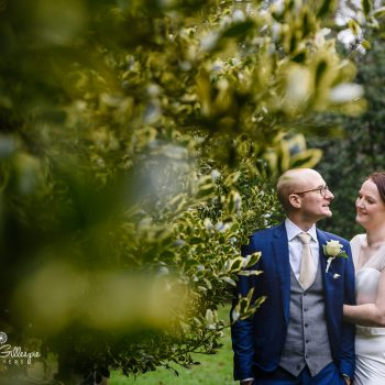 Bride and groom in Hampton Manor grounds